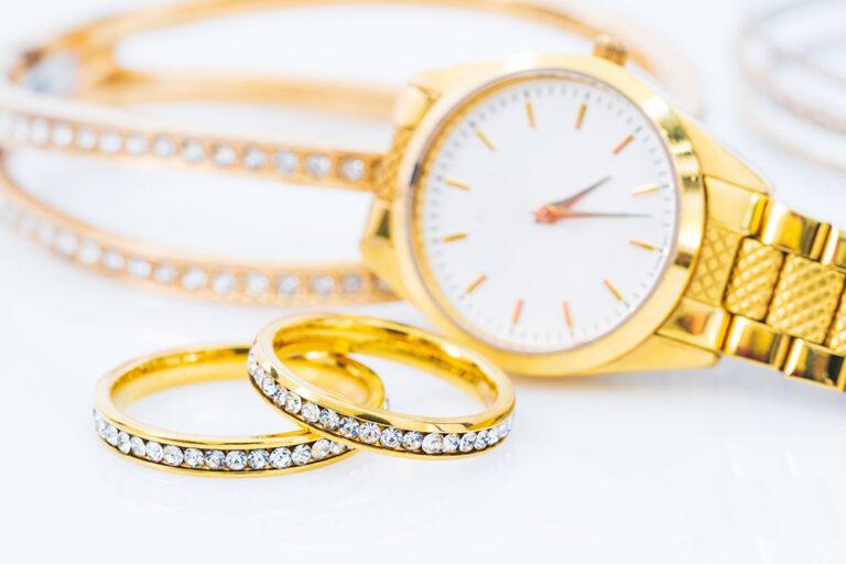 Orologio e verette in oro e diamanti